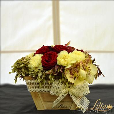 Arrangement with roses, carnations and orchids